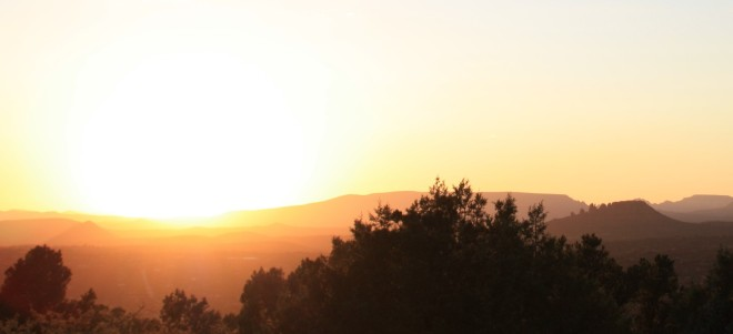Sunset over mountains and trees