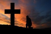 miracle spiritual intervention man at cross praying
