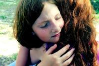 two girls hug in forgiveness