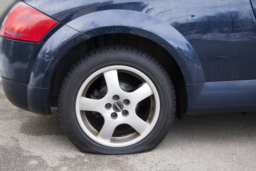 car with front left flat tire