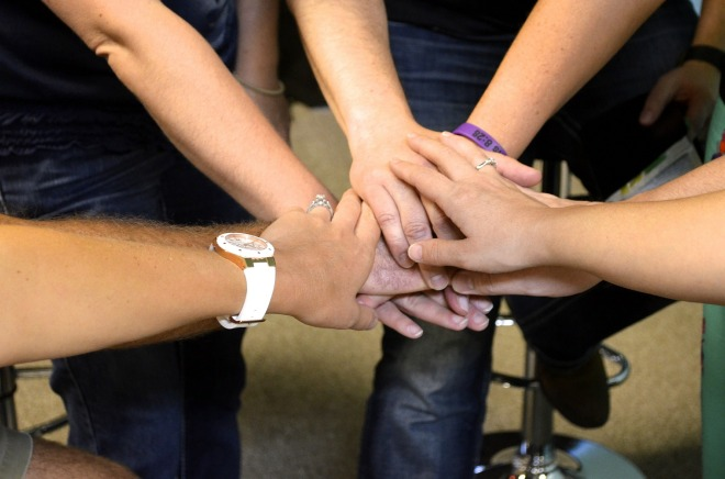 many hands in prayer