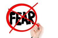 the word fear crossed out with marker by hand