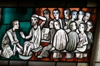 stain glass representation of jesus washing disciples feet