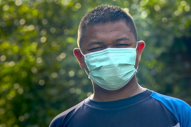man in surgical mask from shoulders up