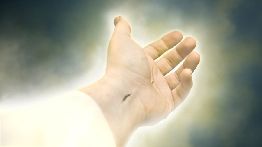 Jesus' glowing hand reching out