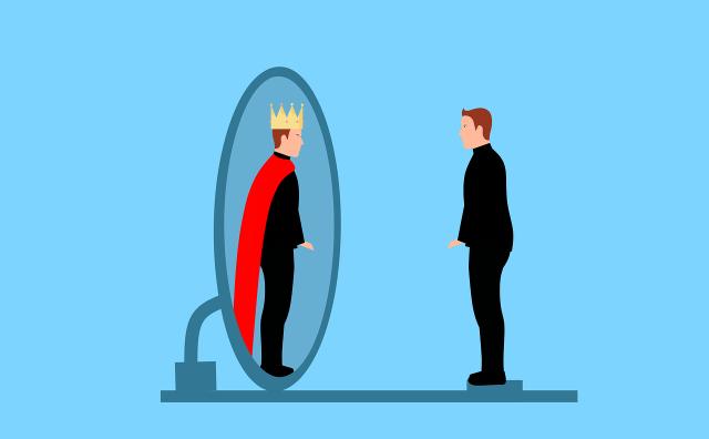 man sees himself in mirror as king