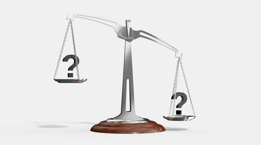 justice scale weighing questions marks